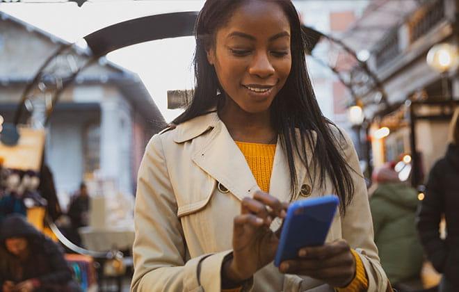 Ebony Howard holding a cell phone