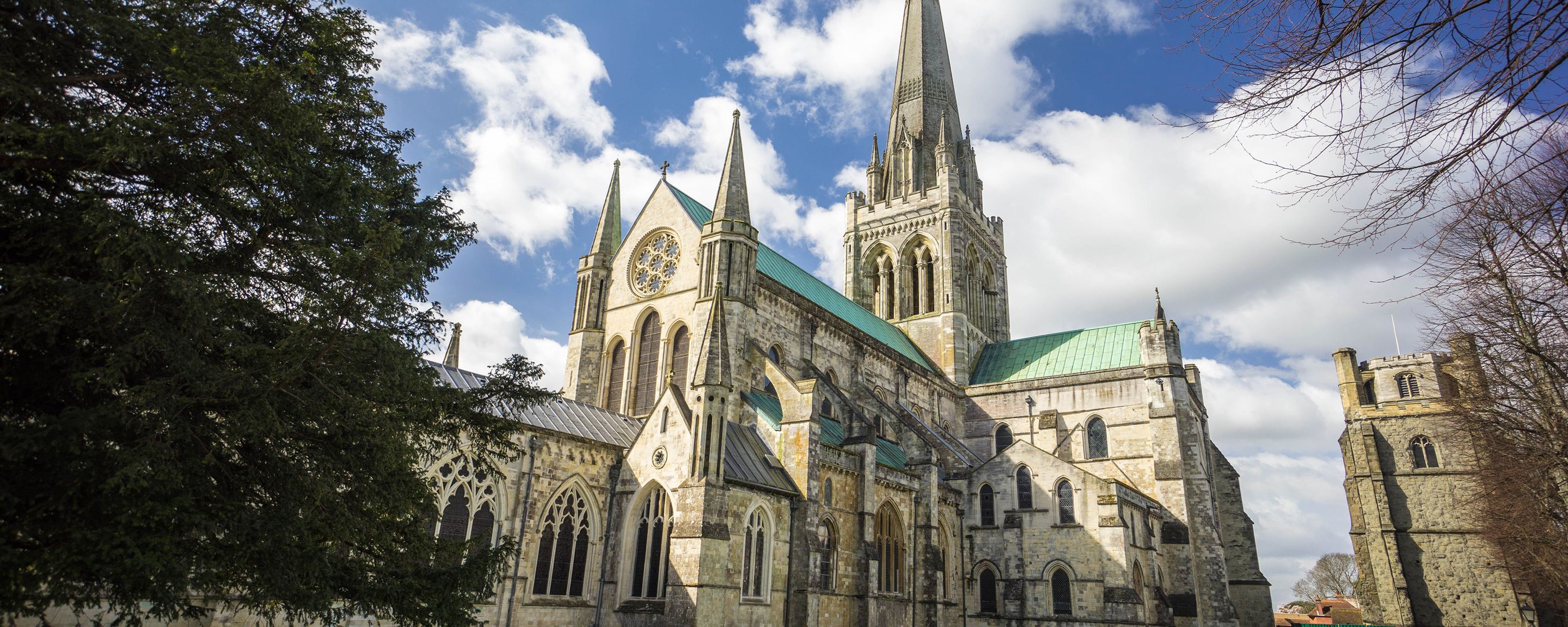 a large stone building with Chichester Cathedral in the background
